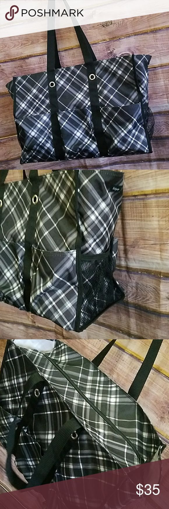 Thirty One super organizing zip top utility tote Thirty One super sized tote measures 14 inches high by 19 and a half inches wide by 7 & a half inches deep. It has a zip top. It has lots of pockets and tons of space.  It is the black and white pick me plaid pattern. Thirty One Bags Totes