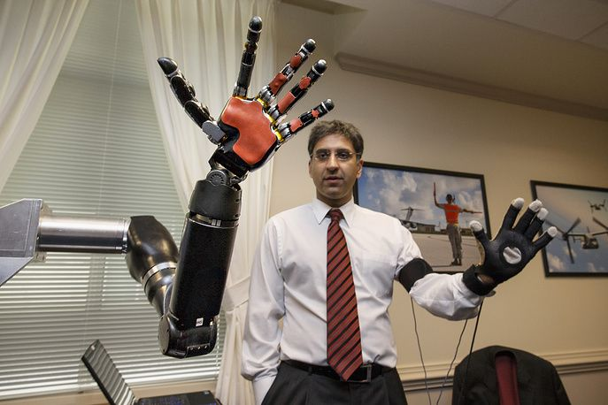 An engineer at Johns Hopkins university demonstrates a robotic hand as the Defense Advanced Research Projects Agency, DARPA, displays the latest high-tech projects being developed for wounded soldiers, Pentagon, USA