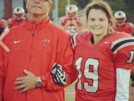 Jeffersonville High School's Shelby Osborne stands with Red Devils assistant football coach Doug Obradovich, left, before a game last season.