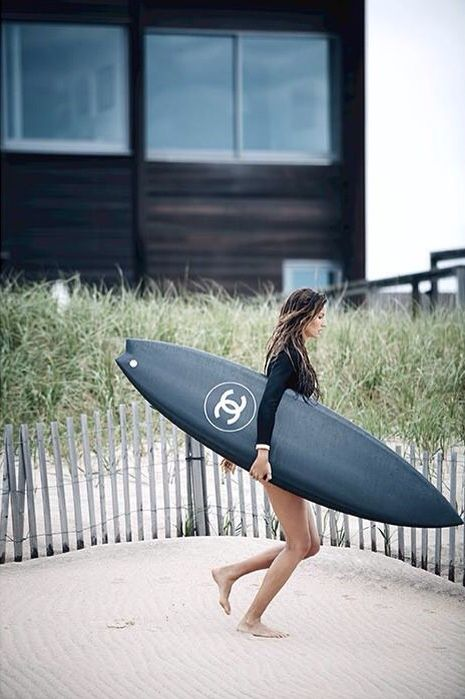 //I don't care how ridiculous the ad was. I want this board more than anything. I would need a leash and wax though, I'm not superwoman like Gisele.