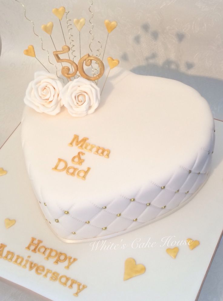 Heart shaped golden anniversary cake