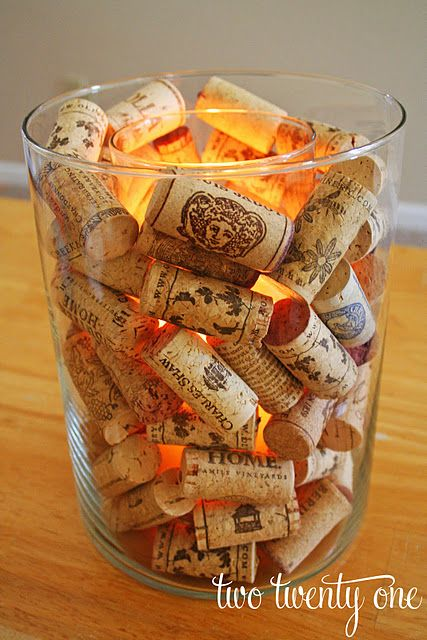 Wine corks in candle holder... Great Idea! We have enough corks to make a dozen of these..