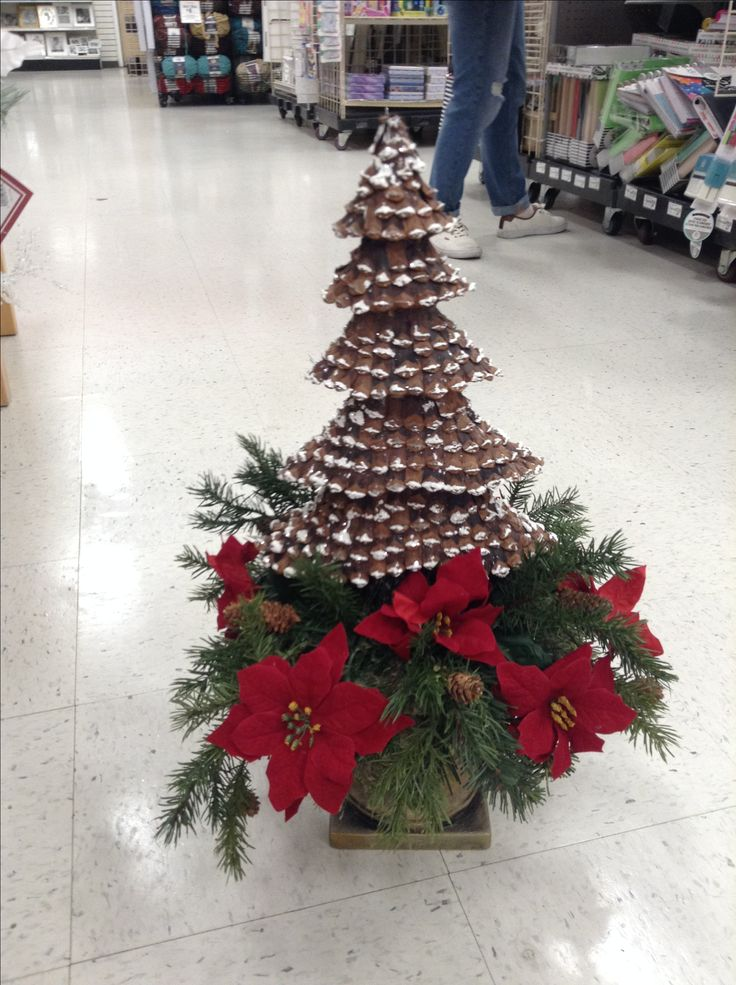 Christmas arrangement of red poinsettias with pine cone for Christmas trees at michaels craft store