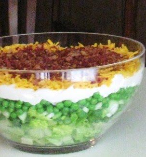 """7 Layered Salad, """"Granny's Recipe""""  I add a layer of hard cooked eggs before the mayonnaise and sprinkle the mayo with a couple tablespoons of sugar.  It helps the dressing liquify somewhat to seep down into the vegie layers. To save time, I purchase """"real"""" bacon bits to top the salad."""
