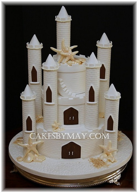 Substitute snowflakes for shells and this would be a winter wonderland castle cake