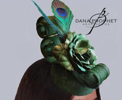 Peacock feathers and a flower add to the already dramatic shape of this gorgeous fascinator. A definite show stopper! https://danaprophetaccessories.com/fascinators/lyric-in-peacock/  #hat #fascinators #races #durbanjuly #horse #horserace #southafrica #style #kentuckyderby #trending #royal #sinamay #celebrations #weddings #bridal  #bridesmaids #derbyhat #headpiece #melbournecup #royalascot #derbyday #Oaksday #accessories #flower #danaprophetaccessories #peacock #green #feathers