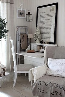 Great little home office fits snugly in the corner of the living....loving the muted pale grey with white colour scheme