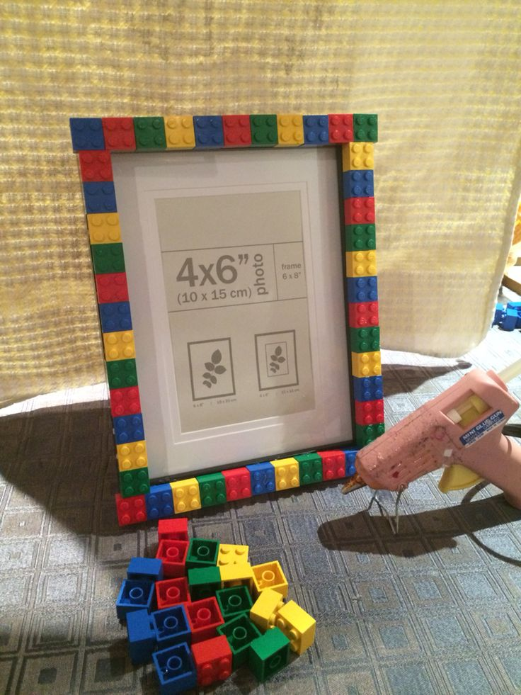 DIY Lego photo frame. Easy to make. Just buy a cheep photo frame and hot glue your Lego to it. Super easy present and very cute.