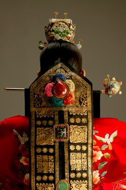 The Dodeurak Daenggi - a long decorative mantle extending from the traditional wedding head gear (coronet) called Hwagwan.