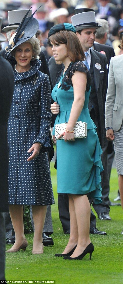 She paired the dress with LK Bennett suede heels, a Piers Atkinson teal hat and Louboutin bag. RIGHT, Eugenie with the Duchess of Gloucester