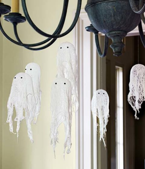 Hang these Halloween ghosts—made of cheesecloth—from the chandeliers!