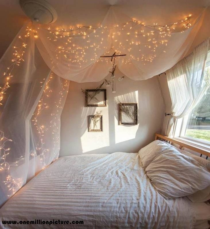 soft canopy bed with fairylights so pretty we did something similar with white sheets bought at the thrift store it was easy cheap and fun to build