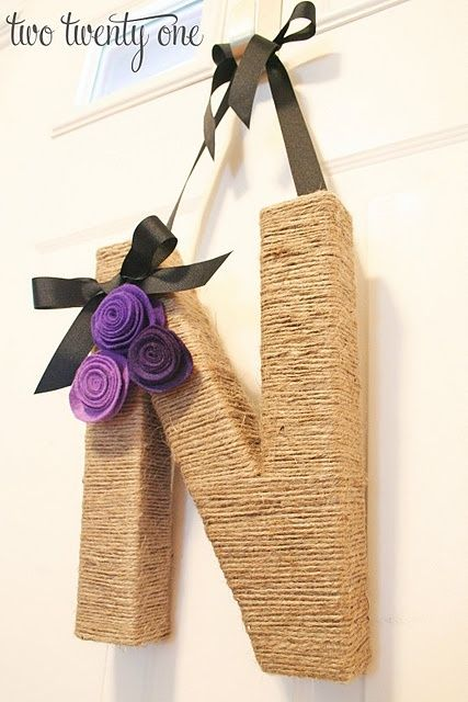 """Letter Wreath. Here's what you'll need:  12"""" paper mache letter ($2.50 from JoAnn with 40% off coupon-- love those!)  2 rolls of jute twine ($1.64 each from Walmart)  felt ($.44 each from JoAnn)  ribbon  glue gun  scissors  I'm so doing this over the summer with different colors of course;) by tiquis-miquis"""