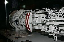 """A tunnel boring machine (TBM) also known as a """"mole"""", is a machine used to excavate tunnels with a circular cross section through a variety of soil and rock strata. They can bore through anything from hard rock to sand. Tunnel diameters can range from a metre (done with micro-TBMs) to 19.25 m to date. Tunnels of less than a metre or so in diameter are typically done using trenchless construction methods or horizontal directional drilling rather than TBMs."""