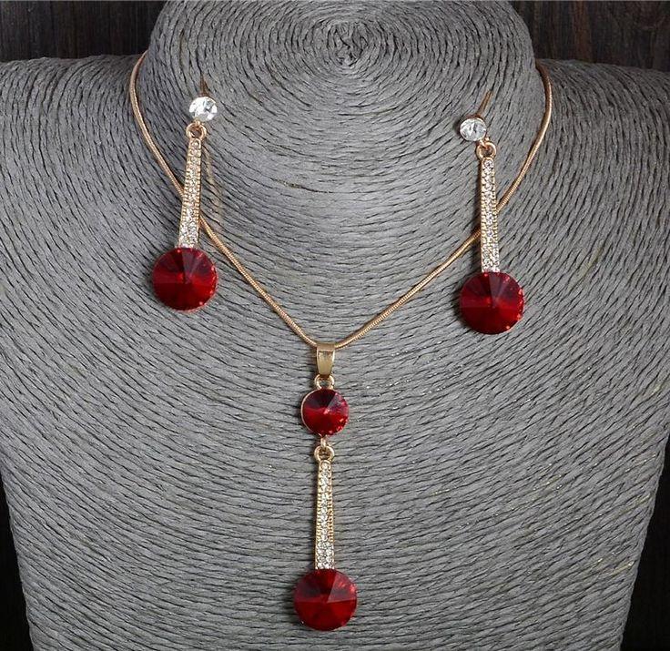 Set bijuterii placat cu aur http://www.bijuteriifrumoase.ro/cumpara/bijuterii-maria-cu-cristale-rosii-1479