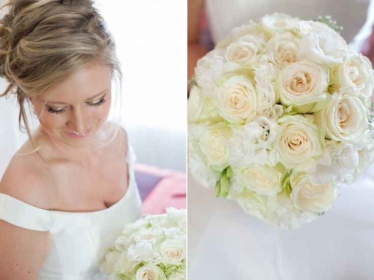 Ball shaped bouquet of white avalanche roses and white Lisianthus. Thanks to Expressions Photography