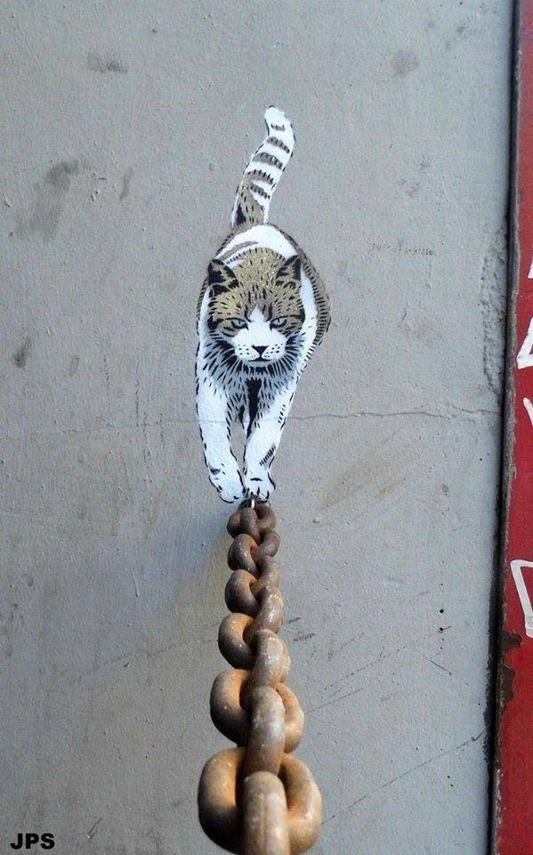 A clever use of an existing piece of chain that cordons off a private car park. Here, this street artist has brought the location to life by drawing a cat onto the wall here