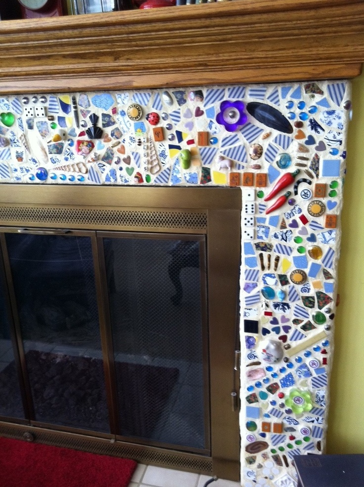 The mosaic fireplace - where broken junk goes to die....this would also make a great backsplash in the kitchen.