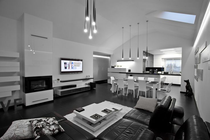 The interior has been built on the principle of contrast: black and white and smooth, painted surface textured porcelain tiles cover the floor of the structure of natural stone.