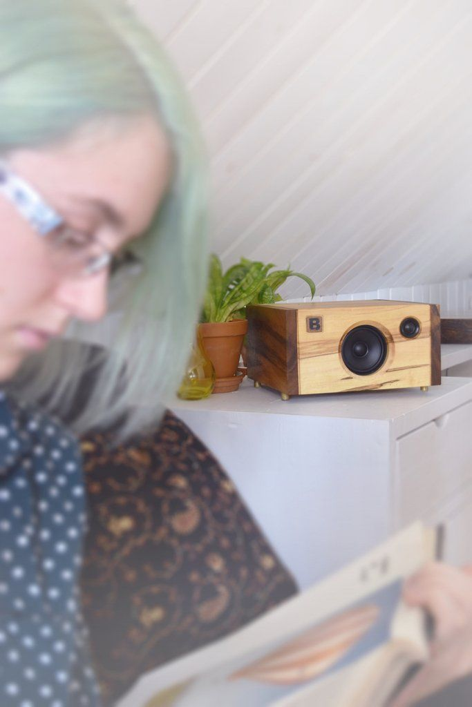 Powerful handmade high-end Bluetooth audio system.  Made of concrete and hard wood.  By PlanB Audio.