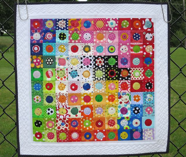 """""""Lotsa Dots"""" - This is made with all polka dotted fabrics......100, in fact. Each square finished at 1 1/2 inches and the total quilt measures 18 1/4""""."""