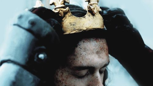 The golden symbol is dull and damaged by the jouney, but still gleams in my gready eyes. Lil reaches up and wipes the sweat from my brow. My hair she brushes carefully away to prepare a resting place for the crown. her hand is drawn back with smears of red, t