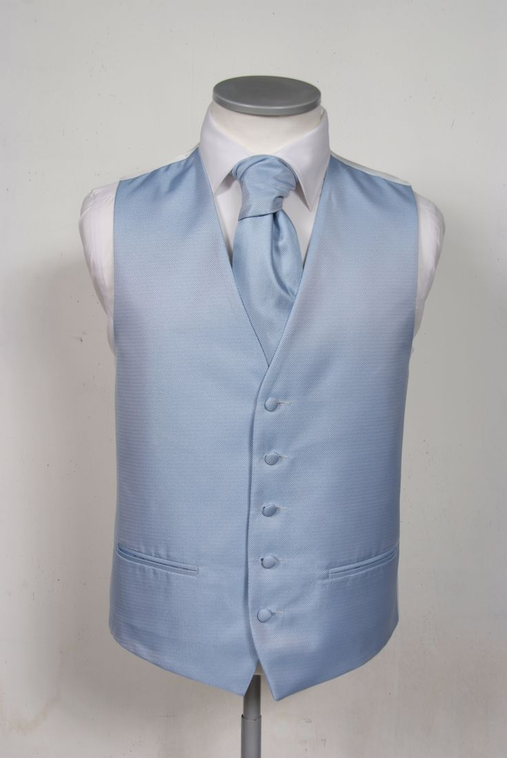 "A modern, elegant Oxford weave effect plainwaistcoat. This 5 button lower cut waistcoat is ideal for a tie or cravat, with 2 working jetted pockets. Mens sizes 36"" chest to 70"" chest and extra long fittings. Boys sizes 20"" chest to 36"" chest. Designed and made in England.  Hire price £30.00"
