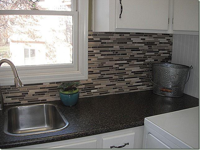 Granite Countertops Through Costco : Costco backsplash on black granite-like counter with white cabinets ...