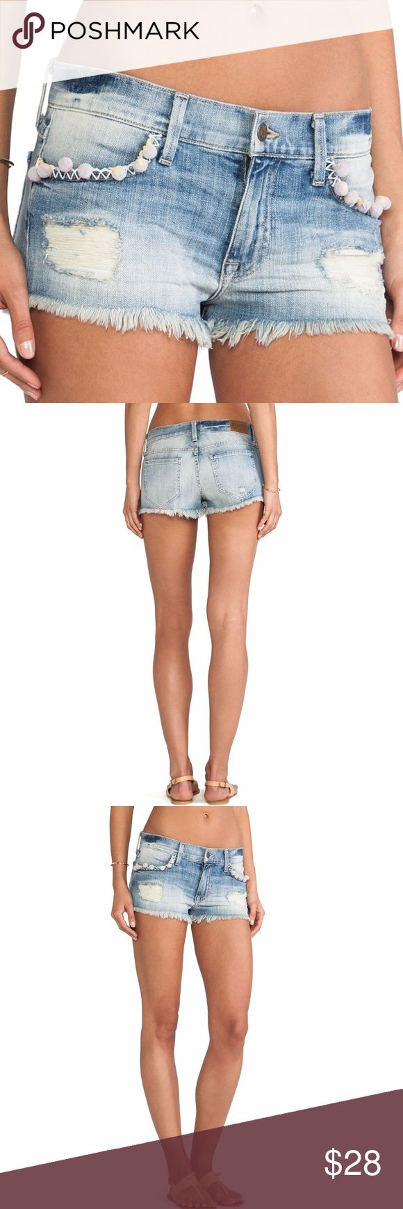 WILDFOX Destructed Lara Taboo Shorts w/Pom Poms 24 LARA SHORTS W/ POM POMS  WILDFOX COUTURE $165  Size 24 waist: 28 hips: 32 rise: 7 1/2 inseam: 1 1/2  98% cotton , 2% spandex Pom pom detail at the pockets Destroyed accents Frayed hem Four-pocket construction  condition: gently used, signs of wears on pom poms smoke-free home Wildfox Shorts Jean Shorts