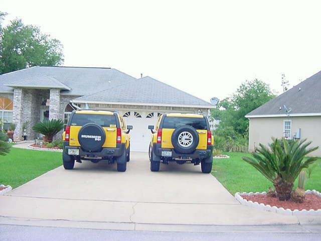Picture #3-Scott has to get matching yellow Hummer in April of 2007. Bonnie's Hummer on left, Scott's on right. 4-2007 after move to Pensacola.