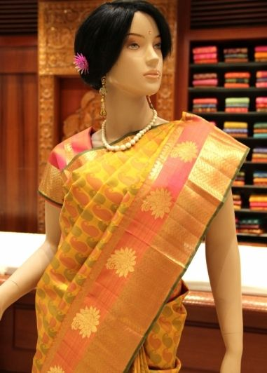 Mustered Colored Self Desiged Small Mango Butta Body with Pink Colored Fancy Jari Bordered Kanchipuram Pure Silk Saree. http://www.shreedevitextile.com/women/sarees/silk-saree/shree-devi/mustered-colored-kanchipuram-pure-silk-saree