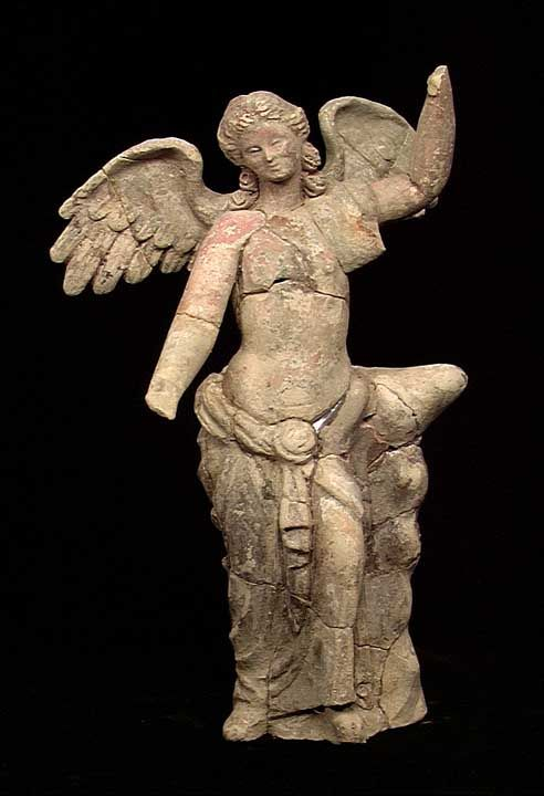 GREEK TANAGRA FIGURE OF NIKE OR EOS, ca. 4th-3rd century BC. The tall slim figure of an winged young maiden, perhaps Eos (Dawn)