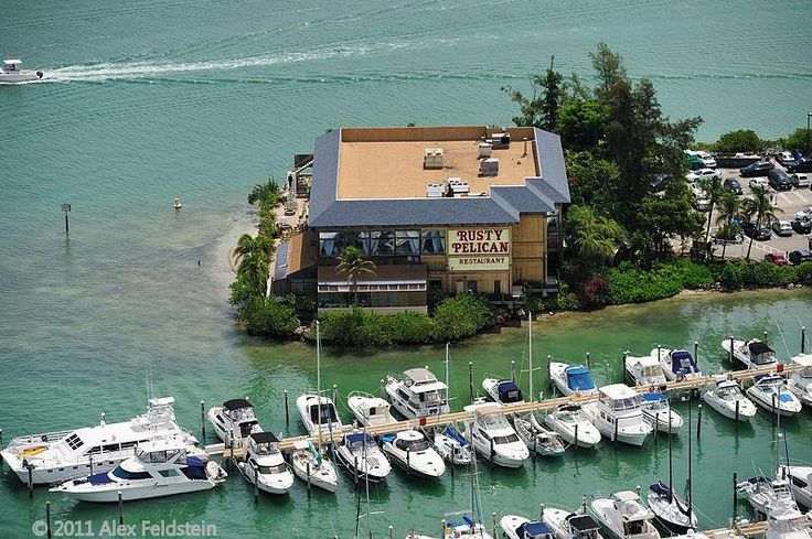 Legendary Rusty Pelican Restaurant on Key Biscayne. It burned down to the ground in the late 80's, it was rebuilt and in August of 1992 it was severely damaged by Hurricane Andrew.