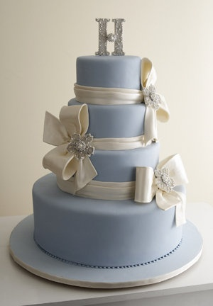 """change color ... love draping around cake and maying instead of bows use large flowers.. although i do like the bows.  i also like the beading trim on the bottom.  I could do without the """"H"""" on top... no need for monogram on cake"""