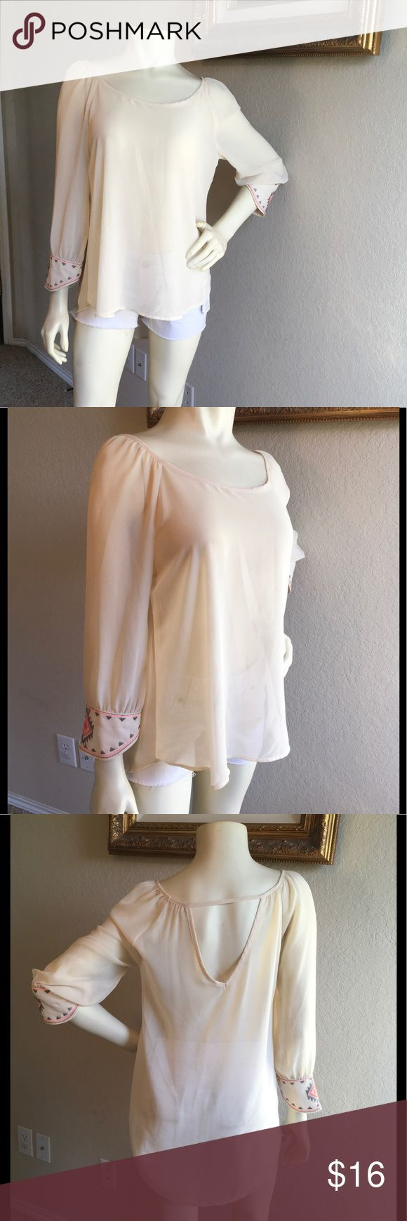 "Sweet Journey Ivory Sheer Top Aztec Stitch Sleeve This beautiful cream ivory color high-low sheer top has Aztec gray and neon pink detail on 3/4 sleeve. Flowy style top and perfect for any occasion, can dress up or down. Back has a peep hole.  Size Medium  Measurements: Bust: 20"" Length: 24 1/2"" (Front) 27 1/2"" (Back) Sweet Journey Tops Blouses"