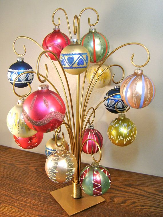 I want something like this for my grandma's old vintage ornaments! They get lost on the tree and this would be a beautiful way to display them every year!