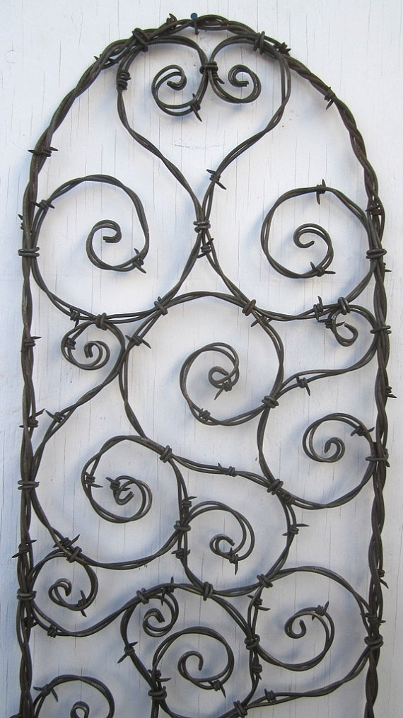 Barbed Wire Trellis. I've pinned this before, but I just love how this trellis design softens old-school barbed wire.