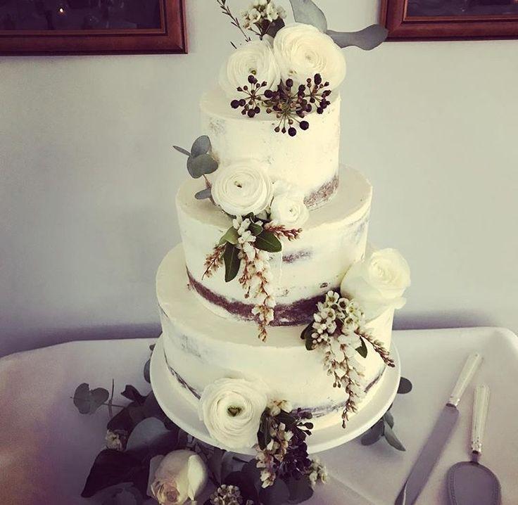 Three tier vanilla cream naked cake with white florals by Bells Dolce #weddingcake #nakedcake #bellsatkillcare #dolce #bellscelebrationcakes #vanilla