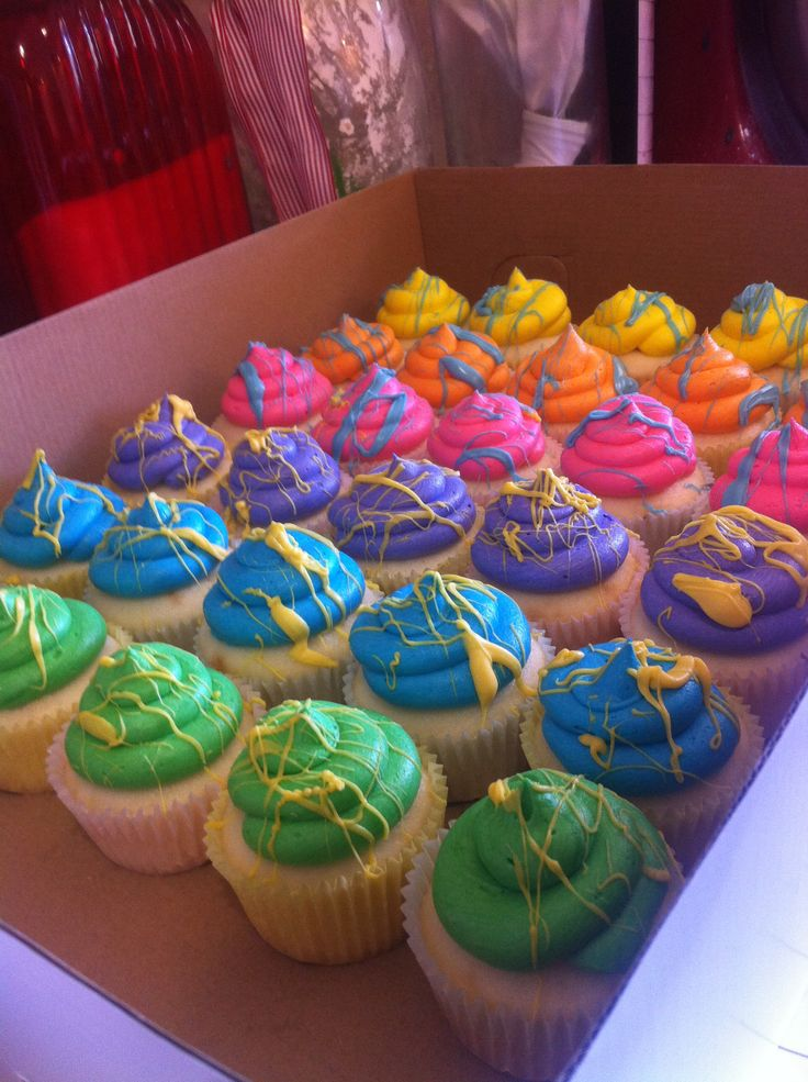 Rainbow paint splatter cupcakes by Facebook.com/ferrissweetscompany