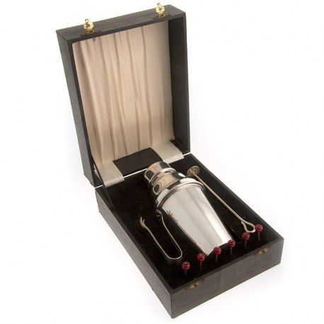 A boxed silver plated cocktail set comprising a plain cocktail shaker, pair of claw ice tongs, six cherry cocktail sticks and stirrer all in the original rectangular lidded box.Circa 1930. #vintage #silver #plate #cocktail #shaker #set #english #epns