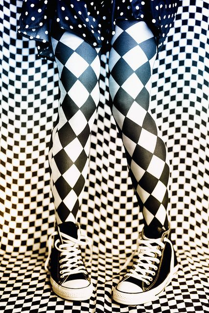 Black and White Harlequin Tights. This would be so cool with these tights, red or black heels and a skirt or dress. Even the converse look good.