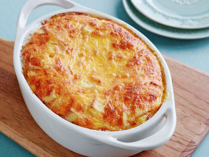"Never-Fail Cheese Souffle : Grated extra-sharp cheddar and slices of white Pullman bread are the secret to this no-fail souffle, a recipe from the mother of Food Network Kitchen recipe developer Bob Hoebee. ""She loves that you set it up the day before and just bake it on serving day,"" he says. via Food Network"