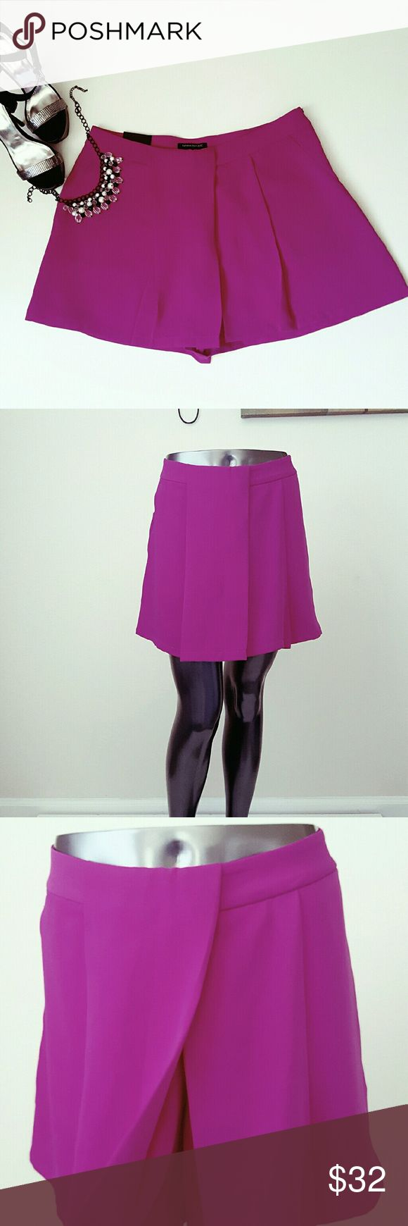 Banana Republic Fuschia Shorts These shorts feature Beautiful Fushia color  The shorts have two pleats down the middle that gives the look of a  skort Two sewn front side pockets  Inseam is 4 1/2  100 polyester Banana Republic Shorts