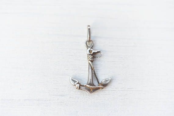 This is a vintage sterling silver nautical pendant. Vintage find, likely Victorian.  The pendant is solid silver, has patina and shine and it has brownish material that acumulated on it in time. I only partly cleaned this, so that it keeps its vintage charm - time is part of its history.
