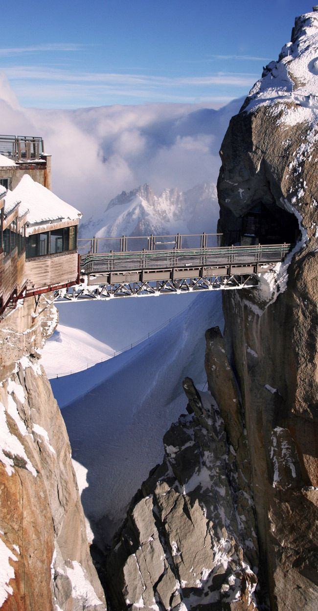 Chamonix,  France Stand on this 'bridge' 13,000 feet above the ground after riding on a breath-taking cable car.  http://www.frenchalpsandprovencetours.com