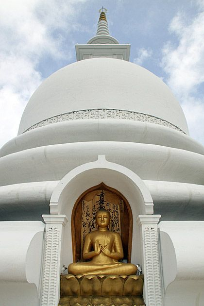 Peace Pagoda in Rumassala -Sri Lanka is designed with Mahayana Buddist Architecture.This Peace Pagoda is designed to provide a focus for people of all races and creeds, and to help unite them in their search for world peace.Great place to visit in GalleClick the link to read more about Sri Lanka http://travelme-srilanka.blogspot.com/