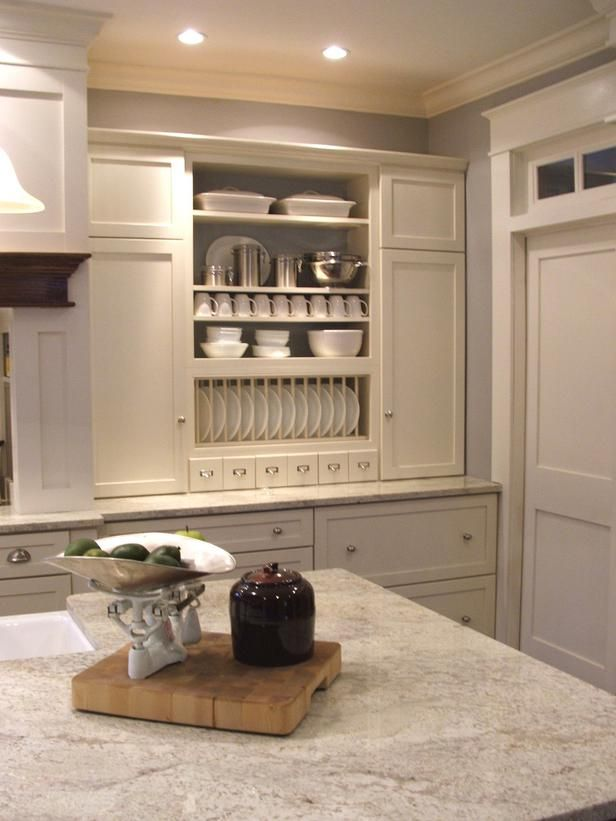These stock cabinets purchased from a mass retailer got a high-end look from the addition of trim and some integrated shelving.