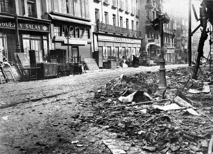 Pando Barrero, Juan Miguel: La calle de Atocha tras un bombardeo