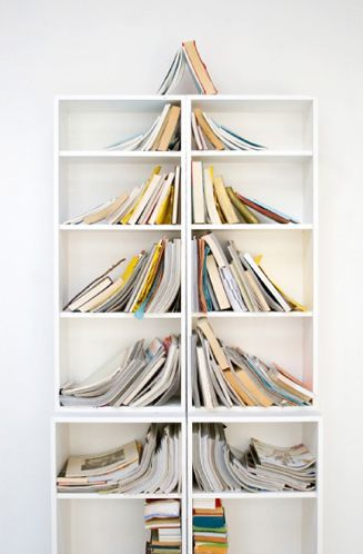 Bookshelf Christmas Tree by curbly: Costs nothing, takes up no room and incorporates books in its design.  #Christmas_Tree #DIY #curbly