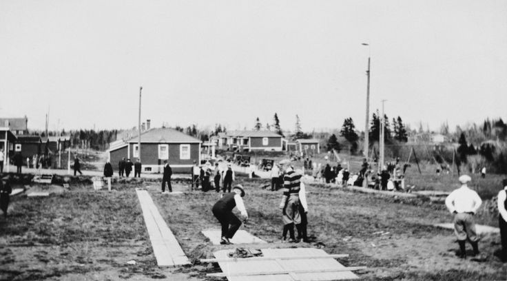 Playing quoits in Imperoyal Village 1920s. Quoits: game in which players toss rings at a stake, called the hob. A ring that encircles the hob scores two points for the thrower; a ring closer to the hob than an opponent's scores one. The rings are usually made of iron and weigh about three pounds, but rope or rubber rings are also used.